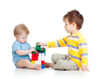 Two kids brothers play together. On white background Stock Photos