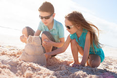 Two kids building sand castle Royalty Free Stock Photo