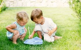Two kids with butterfly net Royalty Free Stock Images