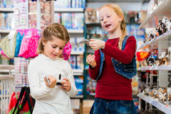 Two kids buying toys in toy store Stock Image