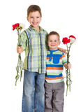 Two kids with carnations Stock Photos