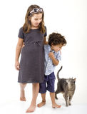 Two kids and a cat Stock Photos