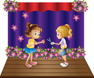 Two kids at the center of the stage. Illustration of the two kids at the center of the stage on a white background Stock Photo