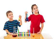 Two kids with chemical flask Royalty Free Stock Photography