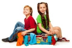 Two kids in clothing basket Stock Images