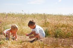 Two kids on country road Royalty Free Stock Photo