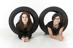 Two kids are crawling through tires Royalty Free Stock Photo
