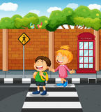 Two kids crossing the  street Royalty Free Stock Photography