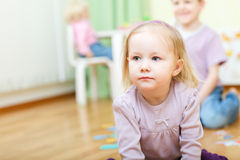 Two kids at daycare. Two little kids indoors in daycare royalty free stock image