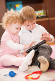 Two kids with digital tablet Stock Image