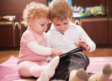 Two kids with digital tablet Stock Photo