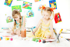 Two kids drawing with color brush. creative childdren Royalty Free Stock Images