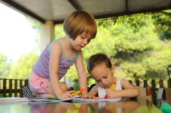 Two kids drawing in a summer school Royalty Free Stock Images