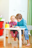 Two kids drawing together Royalty Free Stock Photography