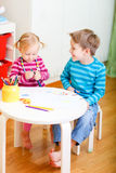 Two kids drawing together Royalty Free Stock Image