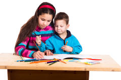 Two kids drawing together Royalty Free Stock Images