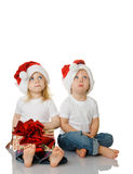 Two kids dreaming about christmas Royalty Free Stock Photos