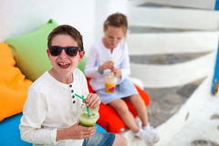 Two kids drinking smoothies outdoors Royalty Free Stock Photography