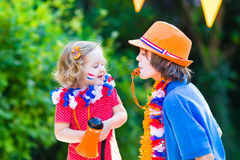 Two kids Dutch football supporters Royalty Free Stock Photo