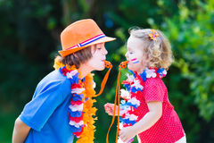 Two kids Dutch football supporters Royalty Free Stock Images