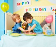 Two kids eating birthday cake Royalty Free Stock Photos
