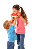 Two kids eating watermelon Royalty Free Stock Image