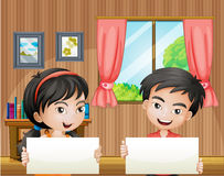 Two kids with empty signboards inside the house Stock Images