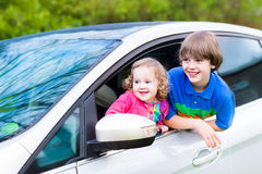 Two kids enjoy vacation car ride on summer weekend Stock Photo