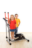 Two kids on a fitness equipment Stock Images