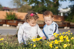 Two kids with flowres Stock Photography