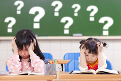 Two kids is full of questions in class Stock Photography