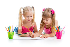 Two kids girls drawing with pencils Royalty Free Stock Image