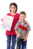 Two kids with greetings for mum Royalty Free Stock Photo