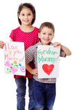 Two kids with greetings for mum Royalty Free Stock Photography