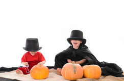 Two kids in Halloween costumes Royalty Free Stock Photo
