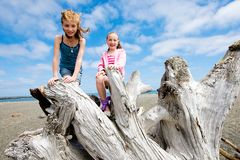 Two kids having fun on a sandy beach Stock Photography
