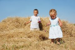 Two kids in hay Stock Photos