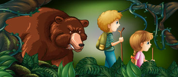 Two kids hiking in deep forest with bear behind Royalty Free Stock Photos