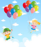 Two kids holding balloons in the sky Royalty Free Stock Images