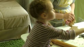 Two kids kneading the dough for make cookies together. 4k stock video footage