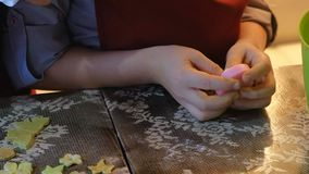 Two kids kneading the dough for make cookies together. 4k stock footage