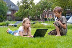 Two kids with laptop Stock Images