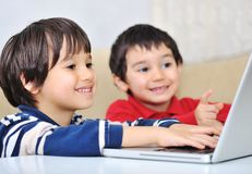 Two kids with laptop Stock Photo