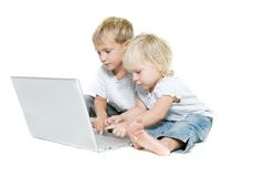 Two kids with laptop Royalty Free Stock Image