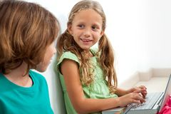 Two kids with laptop. Stock Photos
