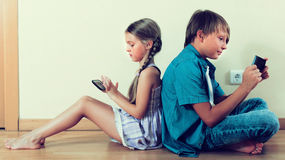 Two kids looking to smartphone screen Royalty Free Stock Photo