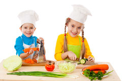 Two kids making salad Royalty Free Stock Image