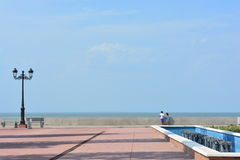 Two kids at the Malecon de Managua pier, Nicaragua. Two kids looking at the Xolotlan lake from the pier of Managua, Nicaragua Royalty Free Stock Photography