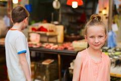 Two kids at market Royalty Free Stock Image