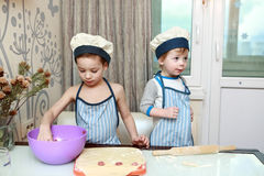 Two Kids mold dumplings Royalty Free Stock Photography